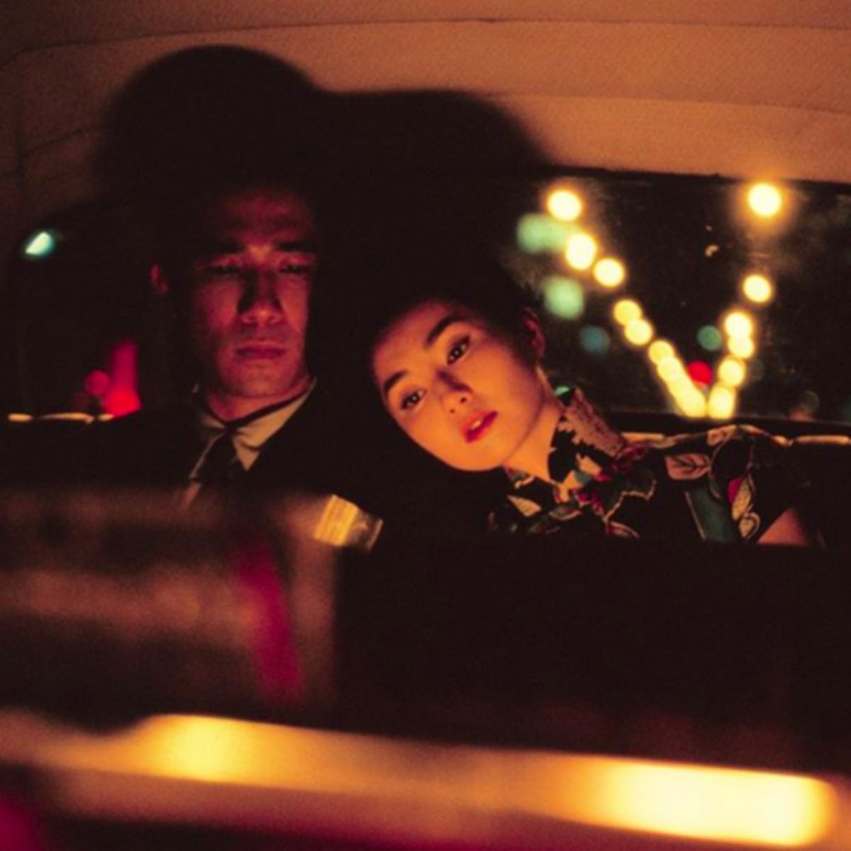 A couple sitting in a car