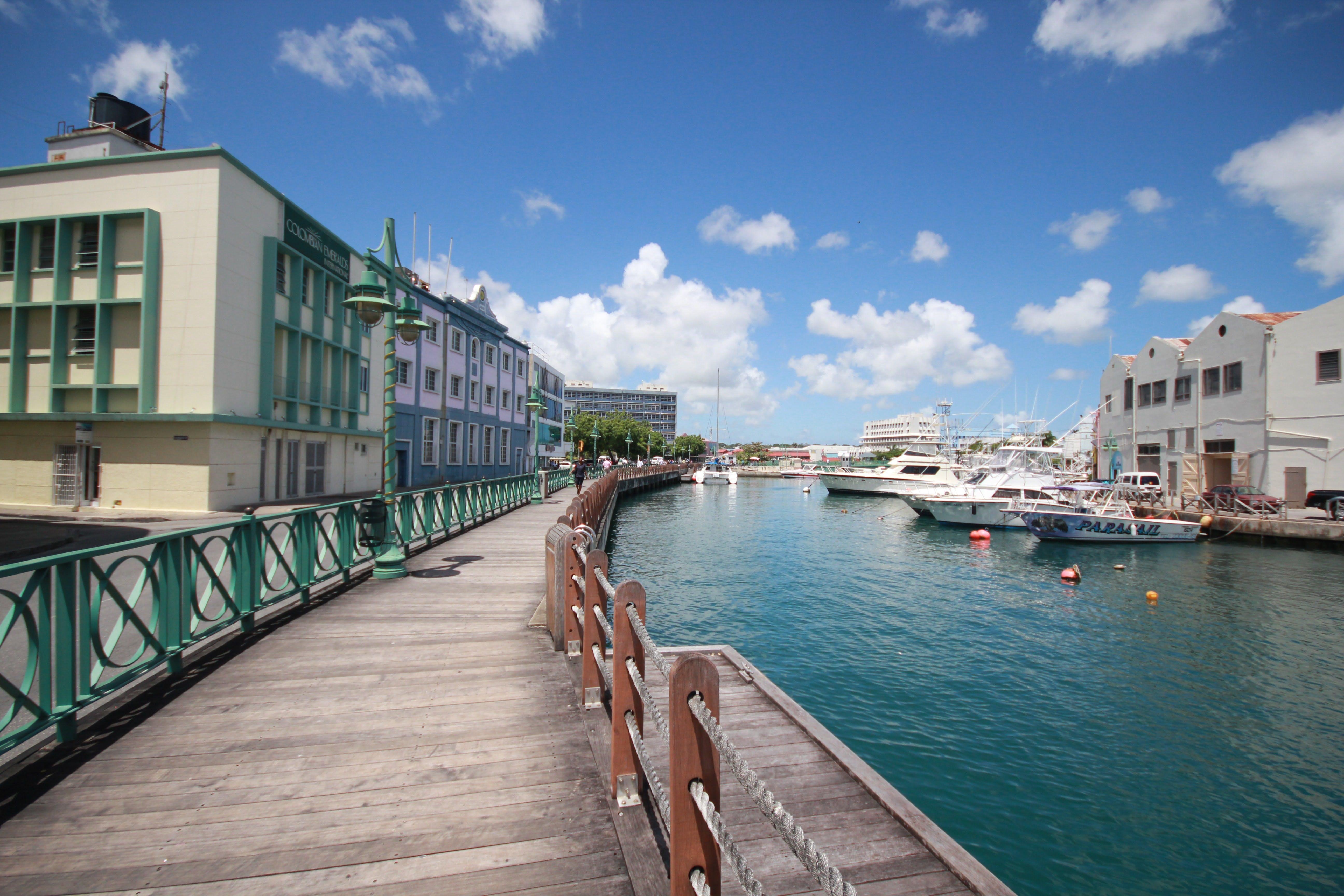 boats docked near buildings
