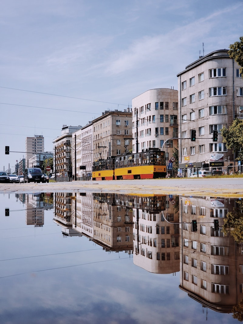 tram in front of buildings