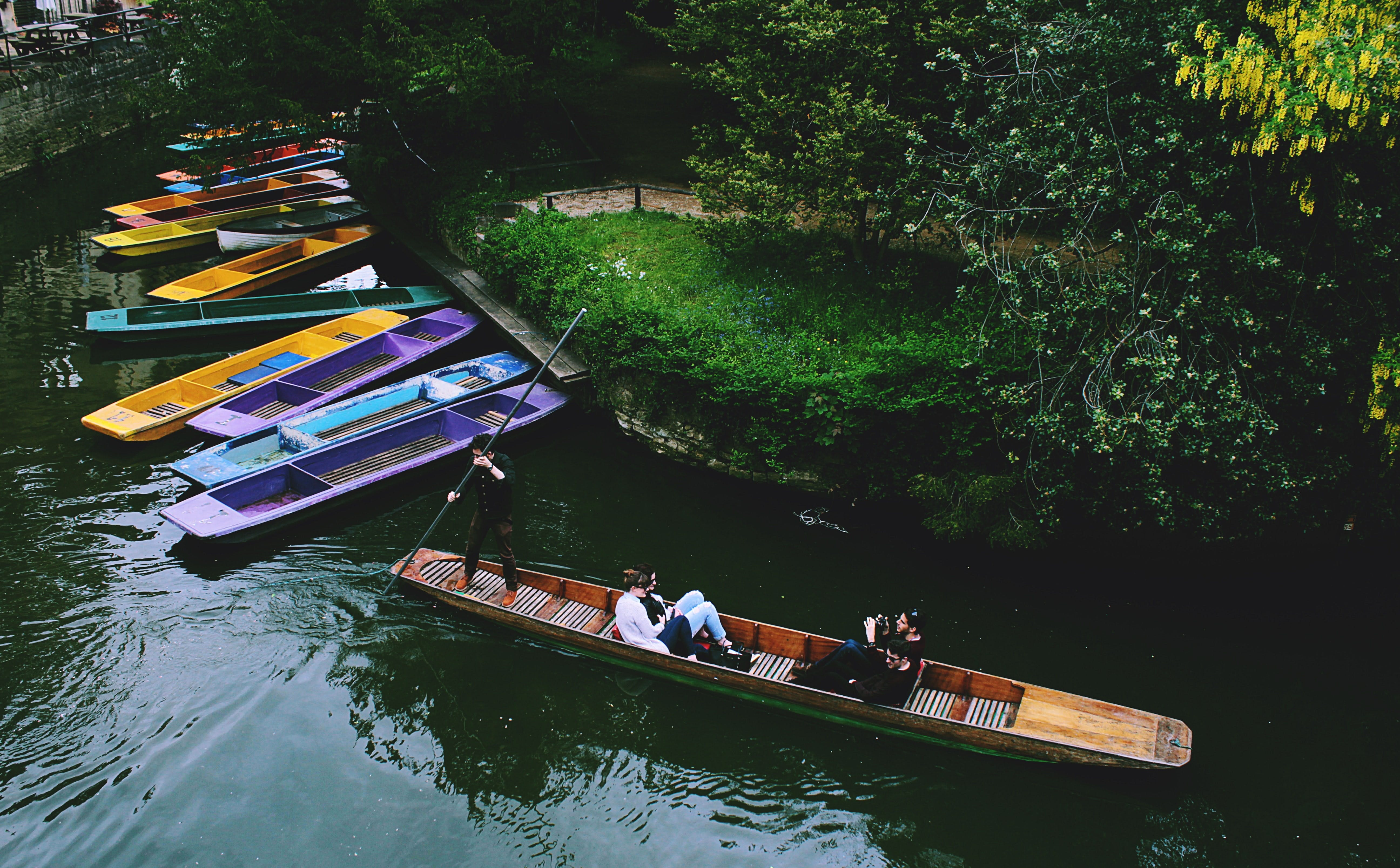 colored boats in canal