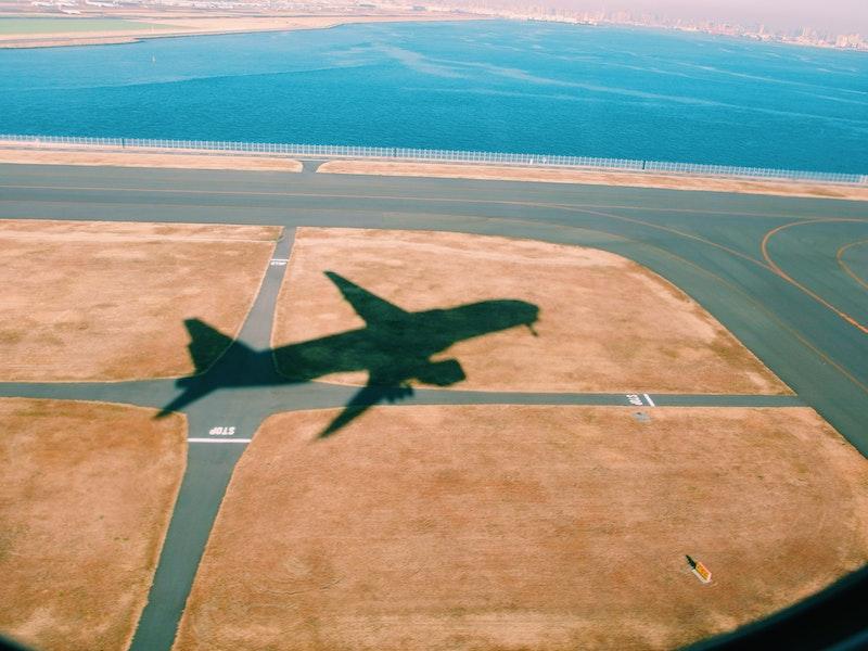 Shadow of plane on runway at Haneda Airport, Japan