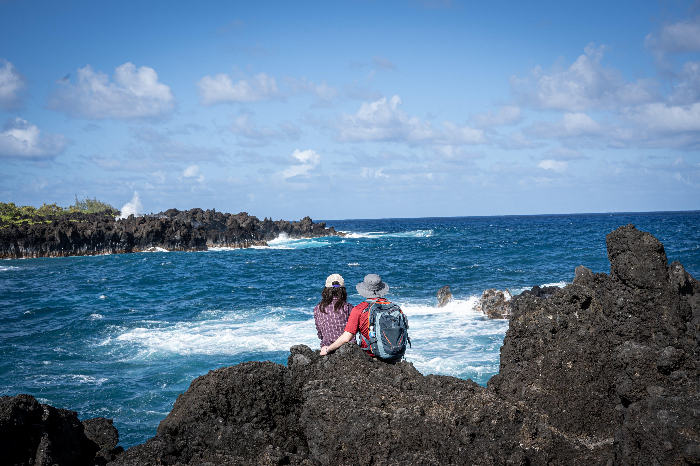 couple on rocks overlooking the ocean