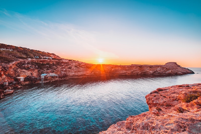 sunset over a rocky cove