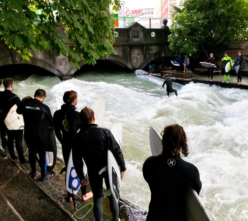 surfers on on the Eisbach river