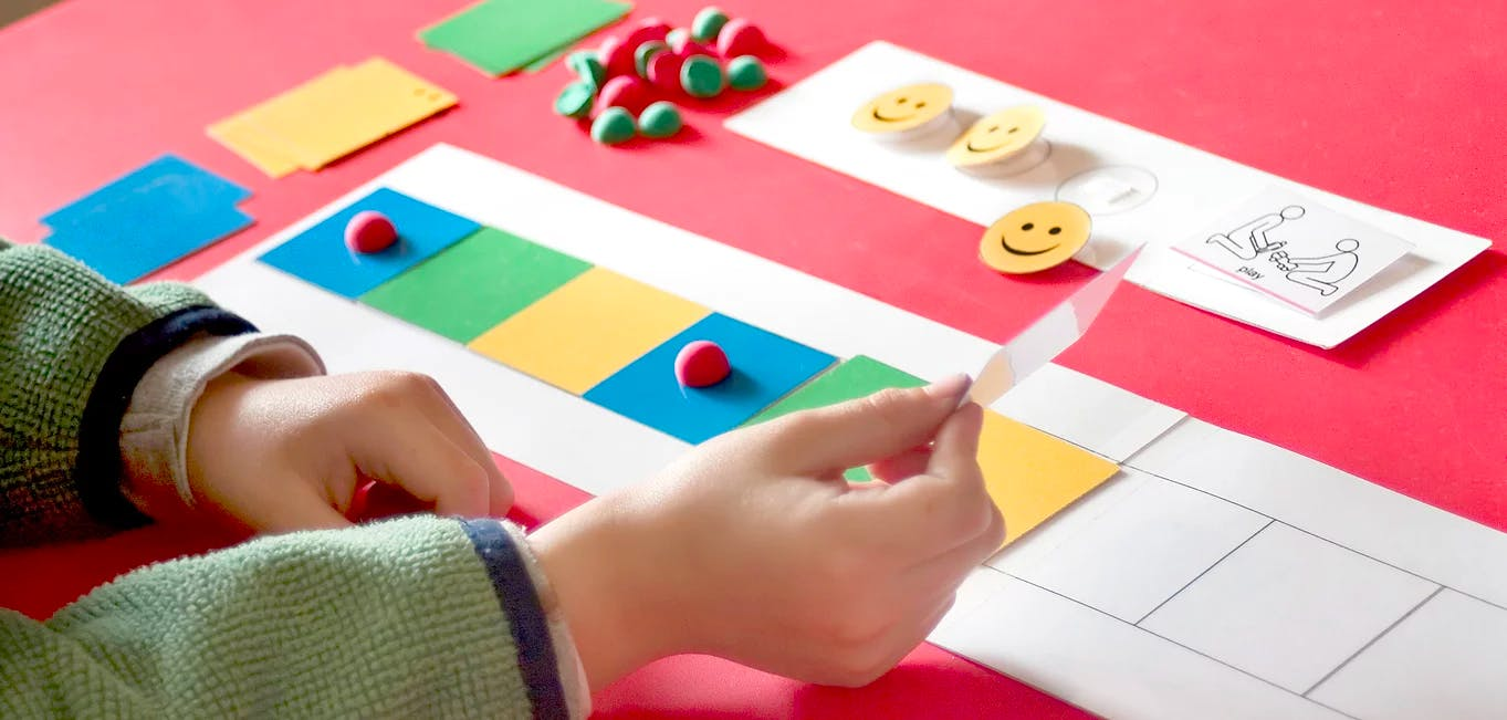 Boy doing activity with colorful pieces