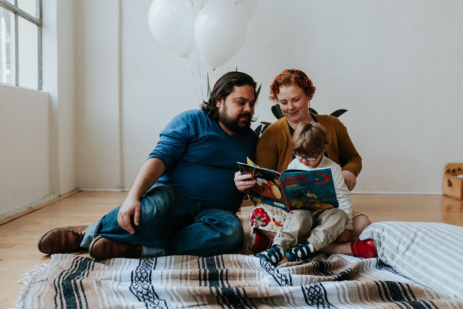 Mom and dad reading to son