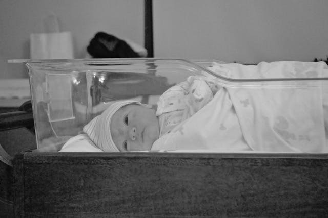 Carter as a newborn in the hospital