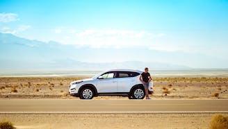 car_in_desert_on_sunny_day