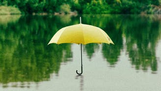 floating yellow umbrella in a lake