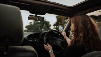 female driving while distracted using phone