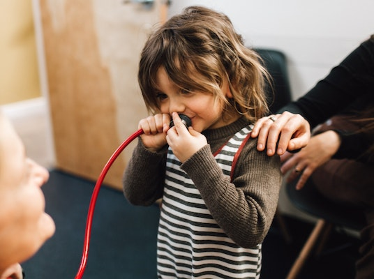 Child holding a stethoscope