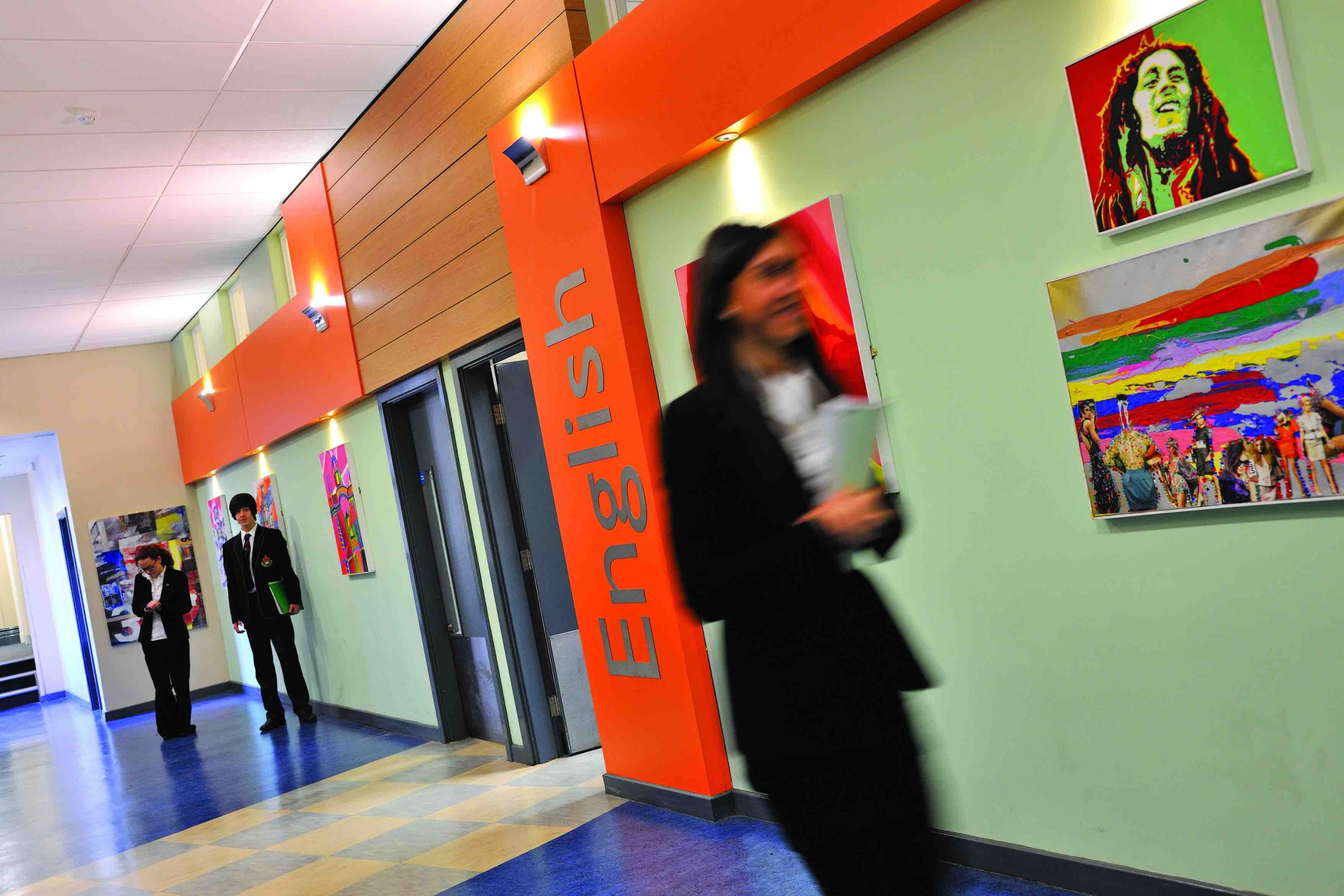 Student in a School Corridor