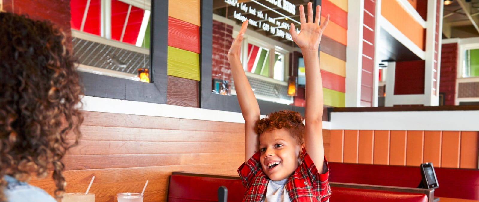 Little Boy Enjoying Dinner at Chili's  Where Kids Eat Free