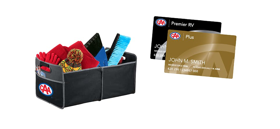 Trunk organizer with winter hat, mittens, snowbrush and ice scraper beside CAA Membership card.