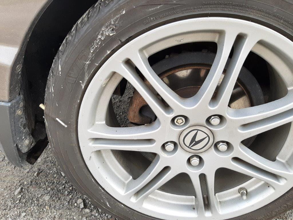 Picture of a wheel with a nail in it. Courtesy of Claire Gorman, CAA Member.