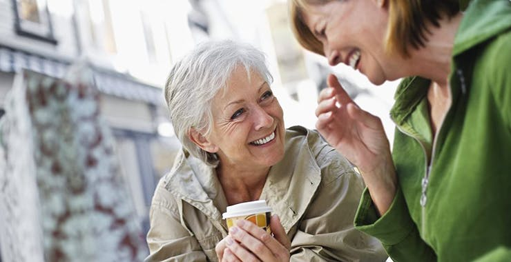 Two senior women laughing and smiling