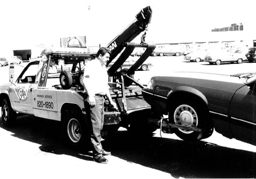 Black and white photograph of old CAA tow truck