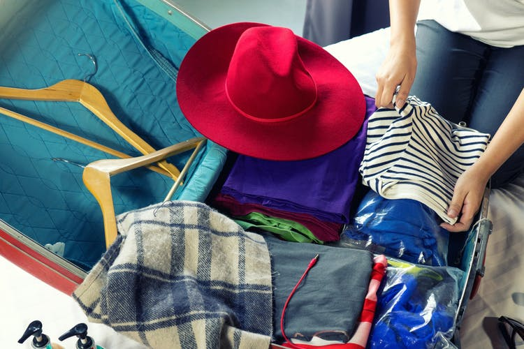 Girl packing luggage for trip