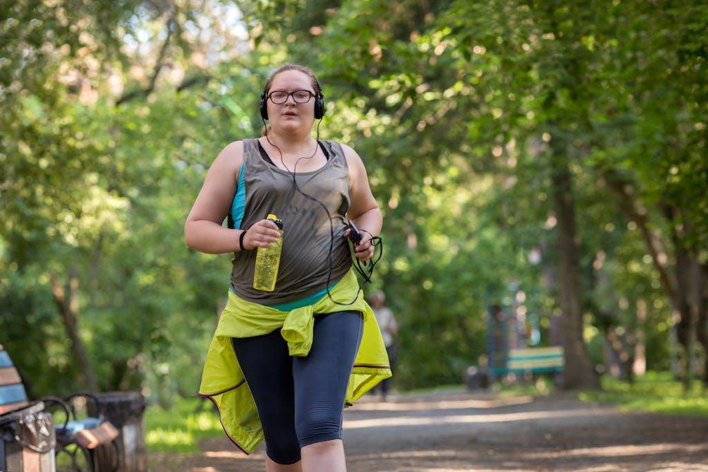 Overweight woman running