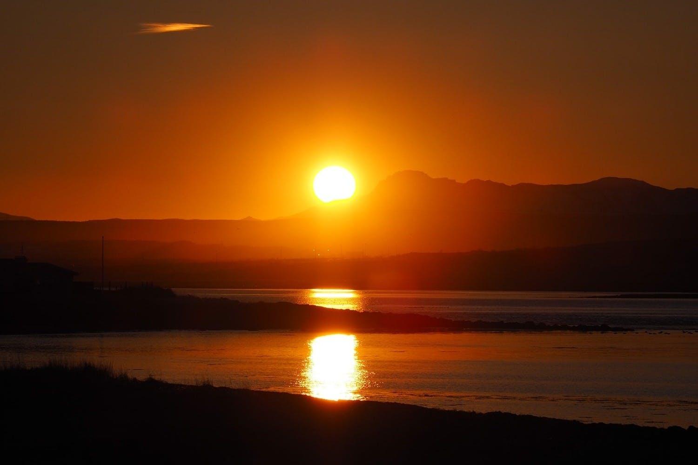 Leinwandbild Traumhafter Sonnenuntergang am Strand