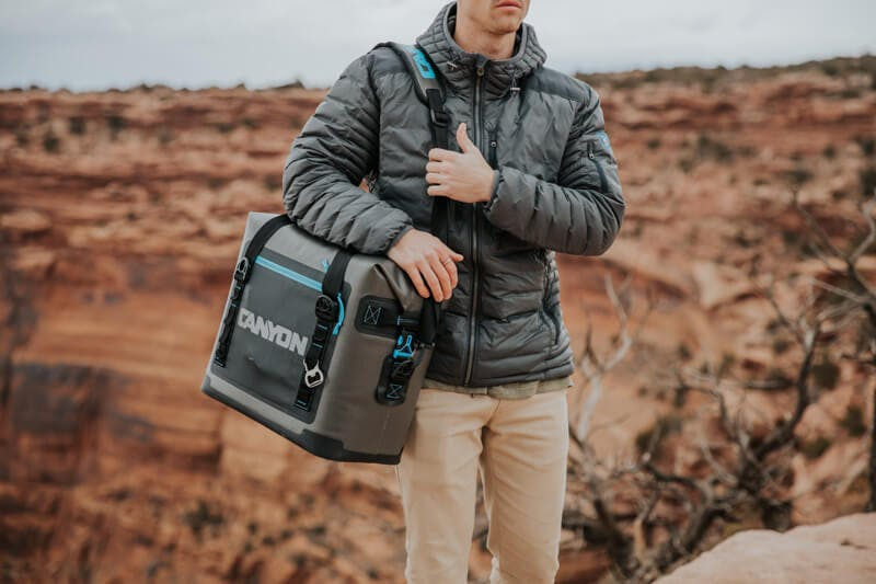 carrying a soft sided cooler