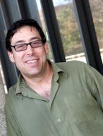 Decorative: Headshot of Dr. Glenn Starkman