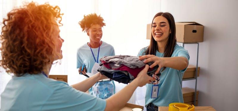 Female entrepreneurs handling clothes.