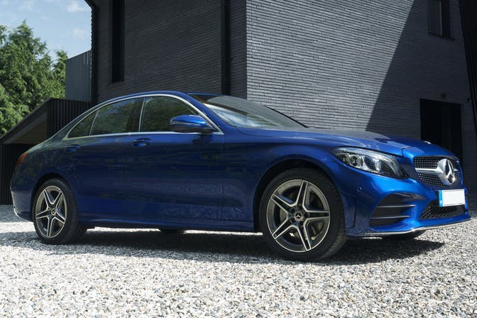 The side exterior of a blue Mercedes-Benz C-Class