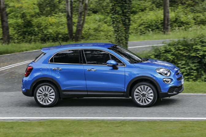 The side exterior of a blue Fiat 500X