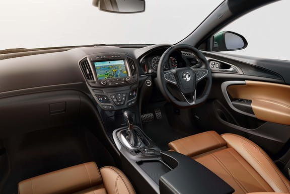The interior of a Vauxhall Insignia with steeringwheel and dashboard in shot