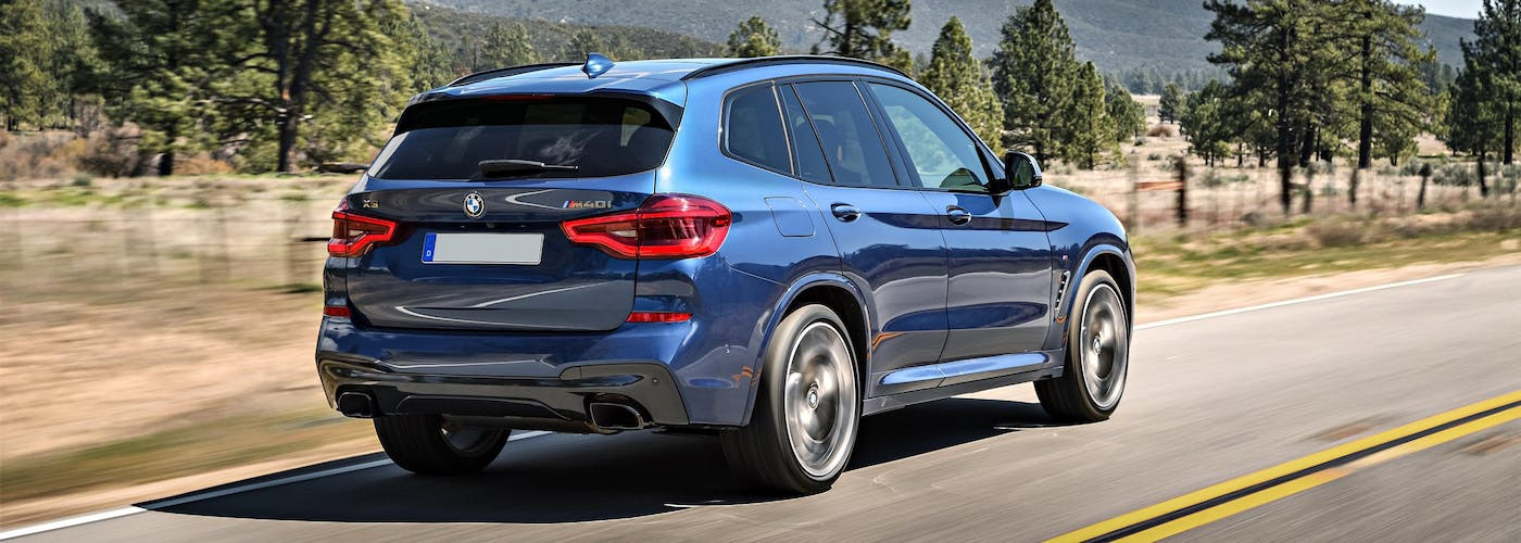The rear exterior of a blue BMW X3