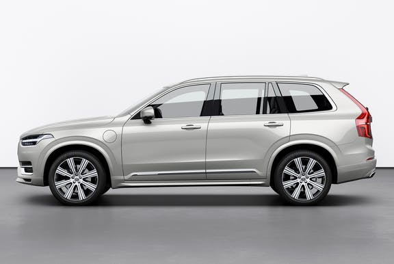 The side exterior of a white Volvo XC90