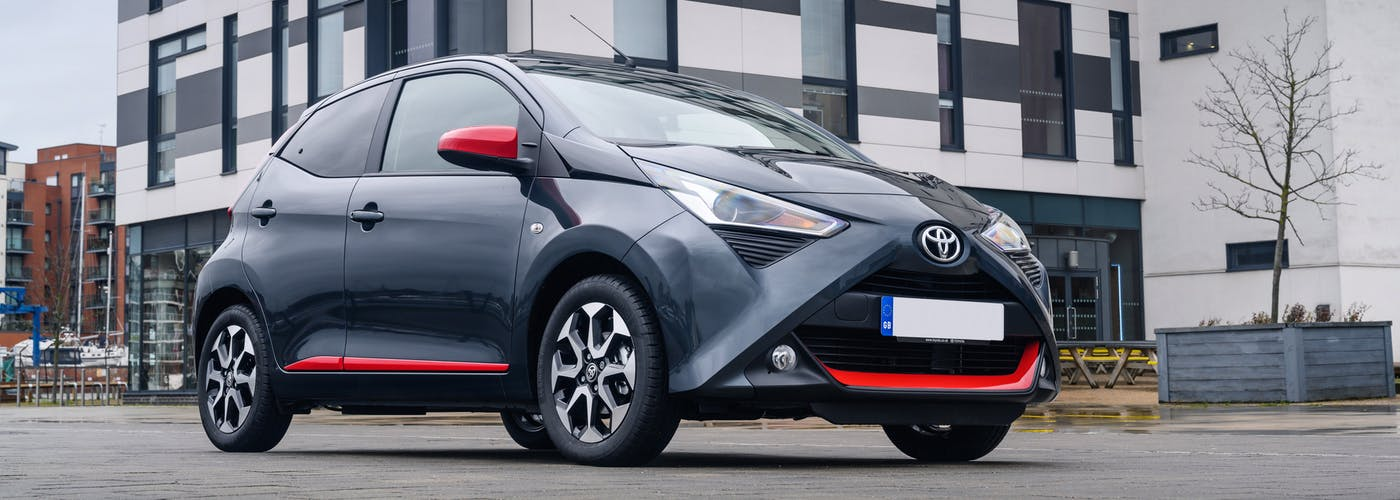 The front exterior of a black Toyota Aygo
