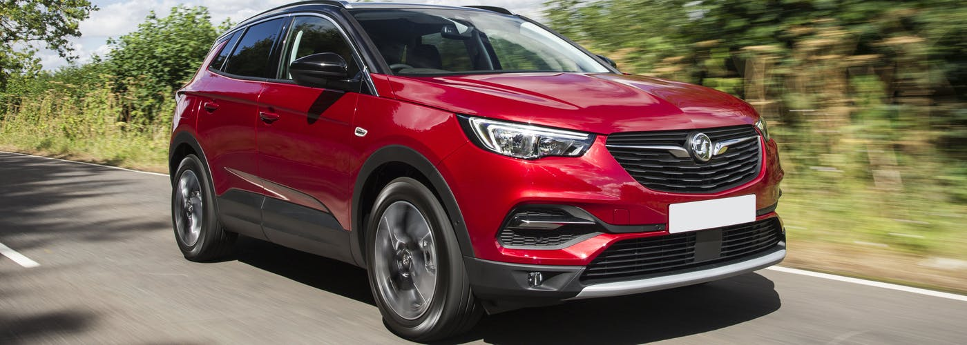 The front exterior of a red Vauxhall Grandland X