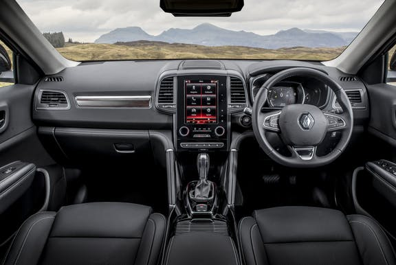 The interior of a Renault Koleos with steering wheel and dashboard in shot