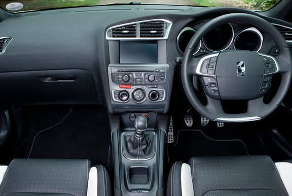 The interior of a Citroen DS4 with steering wheel and dashboard in shot