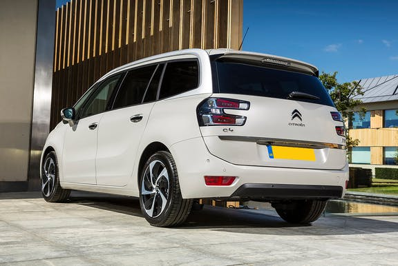 The rear exterior of a white Citroen C4 Grand Picasso