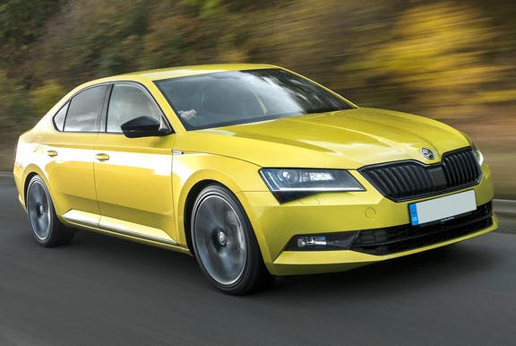 The front exterior of a yellow Skoda Superb