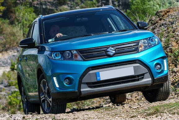The front exterior of a blue Suzuki Vitara