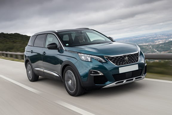 The front exterior of a green Peugeot 5008