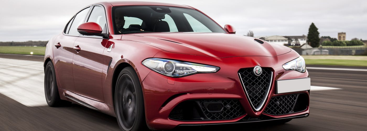 The front exterior of a red Alfa Romeo Giulia