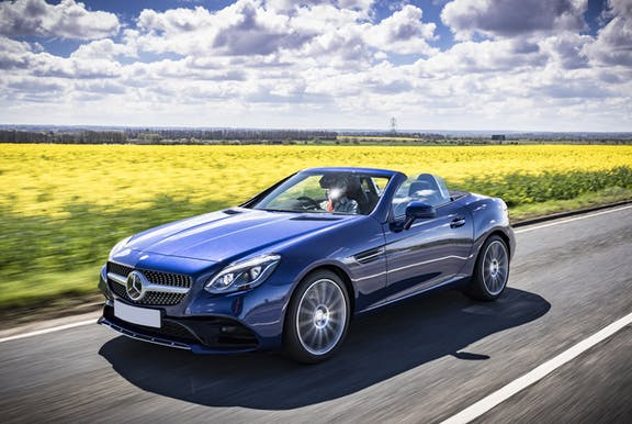 The front exterior of a blue Mercedes-Benz SLC