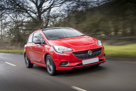 The front exterior of a red Vauxhall Corsa