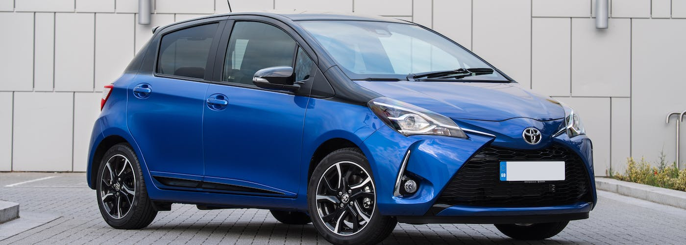 The front exterior of a blue Toyota Yaris