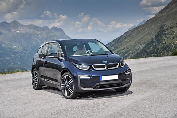 The front exterior of a blue BMW i3