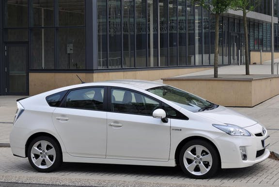 The side exterior of a white Toyota Prius