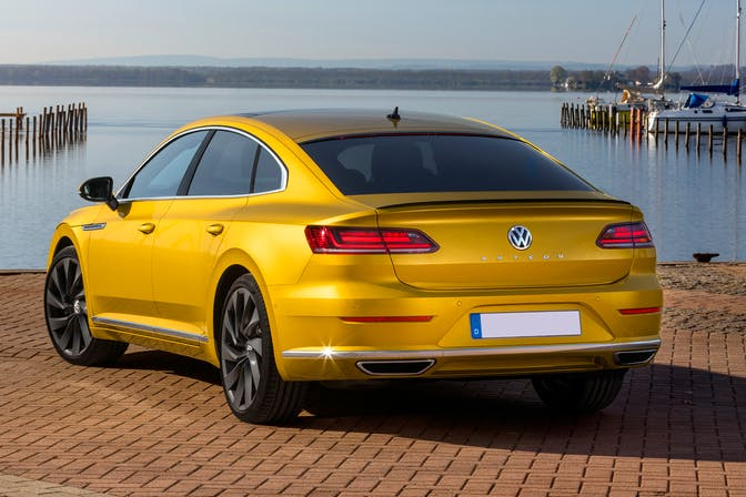 The rear exterior of a yellow Volkswagen Arteon