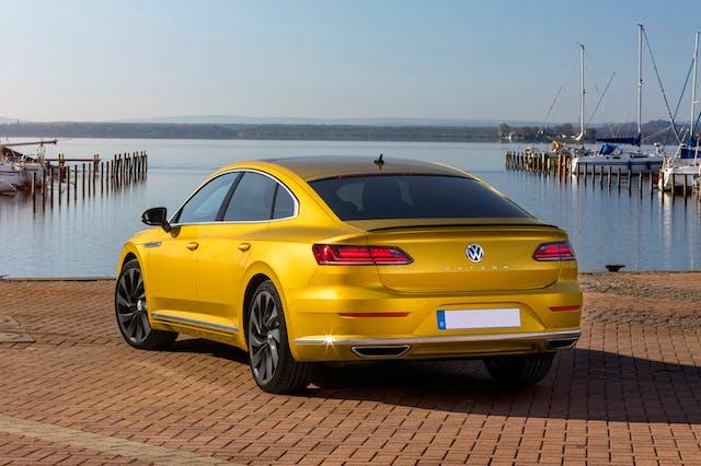 The rear exterior of a yellow Volkswagen Arteon