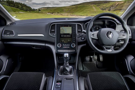 The interior of a Renault Megane with steering wheel and dashboard in shot