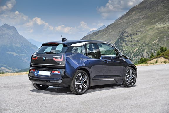 The rear exterior of a blue BMW i3
